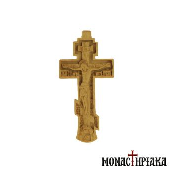 Wood carved pectoral cross with a footstool